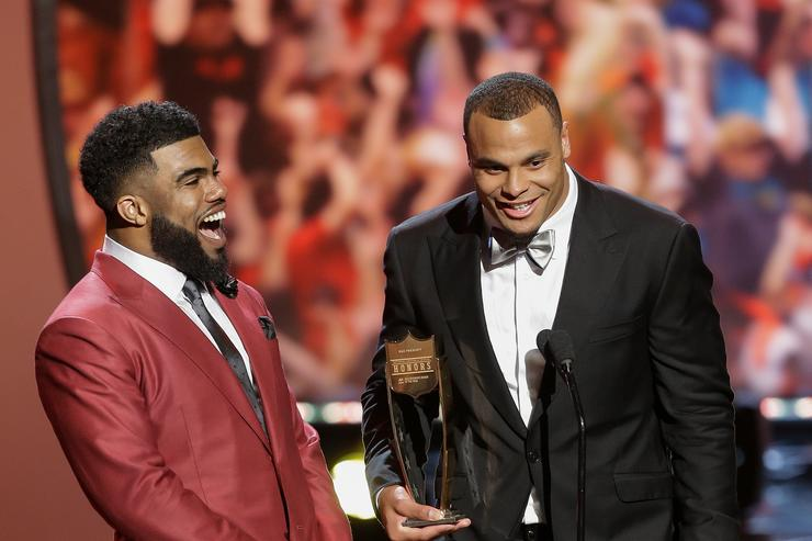Quarterback Dak Prescott, right, excepts the AP Offensive Rookie of the Year with this teammate Ezekiel Elliot during the NFL Honors at the Wortham Theater Center on February 4, 2017 in Houston, Texas.