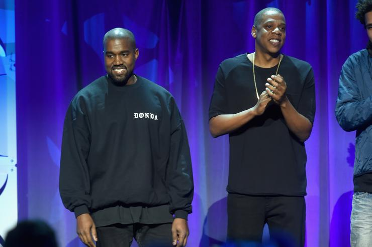 Kanye West (L) and JAY Z onstage at the Tidal launch event #TIDALforALL at Skylight at Moynihan Station on March 30, 2015 in New York City.