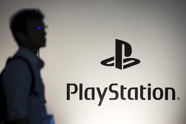 An attendee walks past the PlayStation logo in the Sony Interactive Entertainment booth during the Tokyo Game Show 2018 on September 20, 2018 in Chiba, Japan