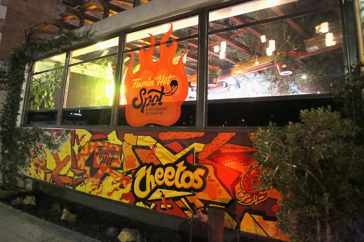Signage on display at The Flamin Hot Spot, Cheetos new limited-time restaurant with a menu inspired by chef Roy Choi at Madera Kitchen on September 19, 2018 in Hollywood, California
