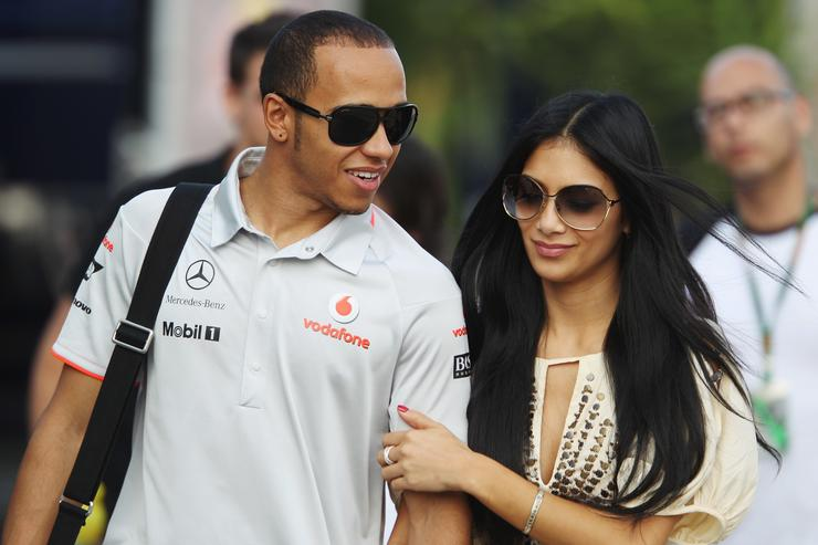 Lewis Hamilton of Great Britain and McLaren Mercedes and his girlfriend Nicole Scherzinger of the Pussycat Dolls walk in the paddock following qualifying for the Turkish Formula One Grand Prix at Istanbul Park on May 29, 2010, in Istanbul, Turkey