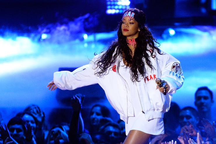 Rihanna performs onstage at the 2014 MTV Movie Awards at Nokia Theatre L.A. Live on April 13, 2014 in Los Angeles, California