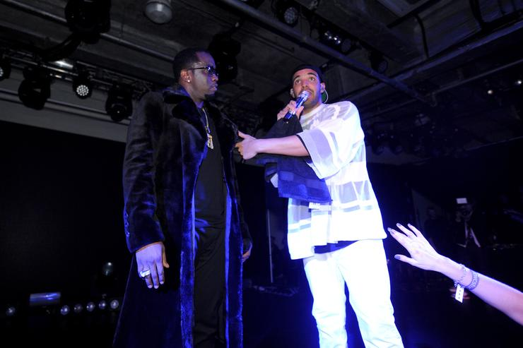 Sean 'Diddy' Combs and Drake perform at the Time Warner Cable Studios and Revolt Bring the Music Revolution event on February 1, 2014 in New York City