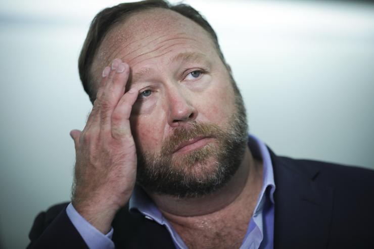 Alex Jones of InfoWars talks to reporters outside a Senate Intelligence Committee hearing concerning foreign influence operations' use of social media platforms, on Capitol Hill, September 5, 2018 in Washington, DC