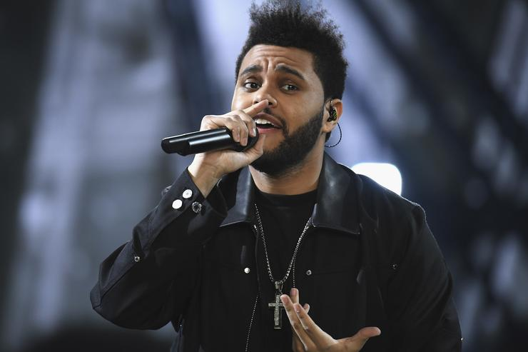 Weeknd performs during the runway at the Victoria's Secret Fashion Show on November 30, 2016 in Paris, France
