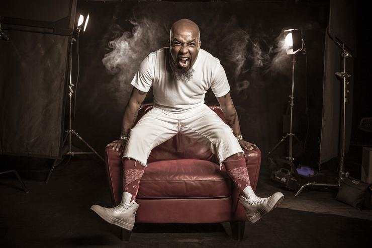 """Tech N9ne poses for a promotional photo of the """"Strictly Strange"""" tour."""