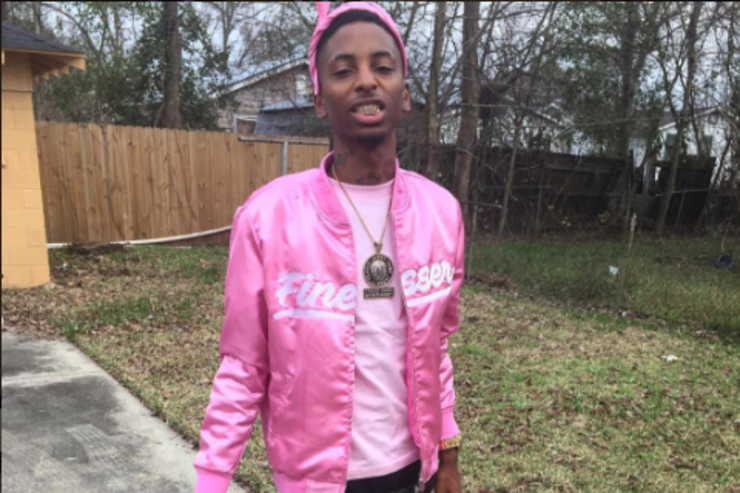 22 Savage rocks out in a pink bomber jacket.