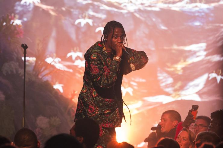 Travis $cott performing at Nike Lab Ricardo Tisci event.