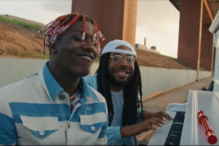 "Lil Yachty and D.R.A.M. sit next to a piano in the video for ""Broccoli."""