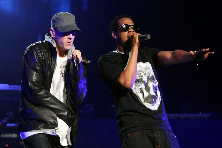 Jay-Z and Eminem perform together on-stage at the launch of 'DJ Hero' at the Wiltern Theatre on June 1, 2009 in Los Angeles, California.