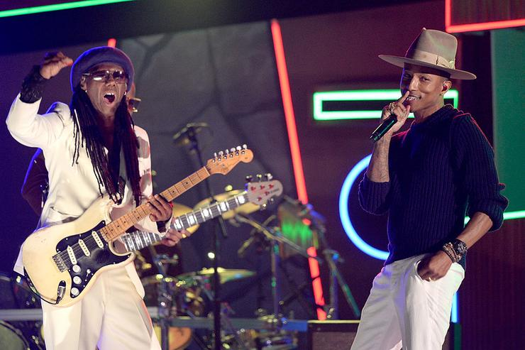 Musician-producers Nile Rodgers (L) and Pharrell Williams perform onstage during the 56th GRAMMY Awards at Staples Center on January 26, 2014 in Los Angeles, California.