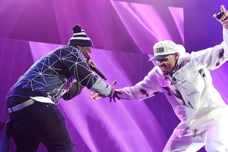 50 Cent (L) and Chris Brown perform onstage during the 'Between The Sheets' tour at Barclays Center of Brooklyn on February 16, 2015 in New York City.