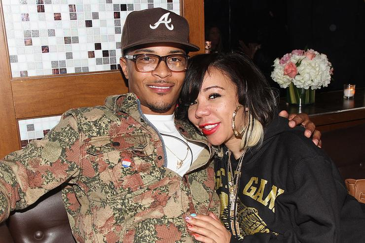 (L-R) T.I. and Tameka Tiny Cottle-Harris attend Moet Rose Lounge presents T.I., a celebration for his new album Trouble Man: Heavy is The Head at Baoli on November 20, 2012 in Miami, Florida.