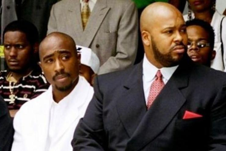 Tupac Shakur and Suge Knight attend a social event.