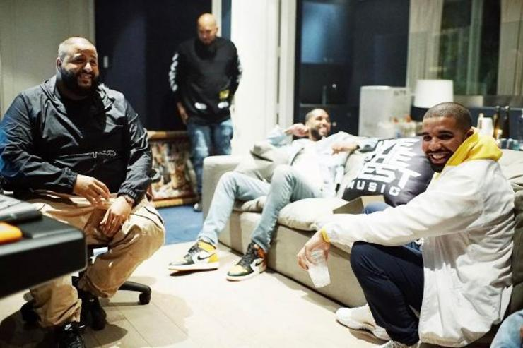 DJ Khaled, Drake and their team hang out in the studio.