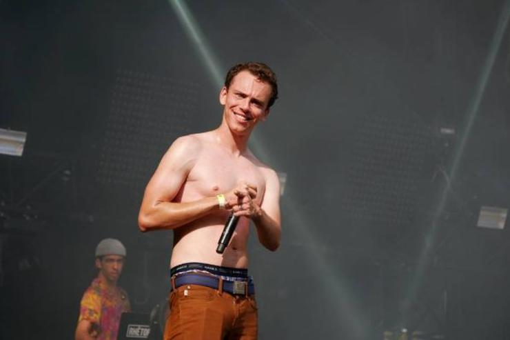 Logic performs onstage at a show.