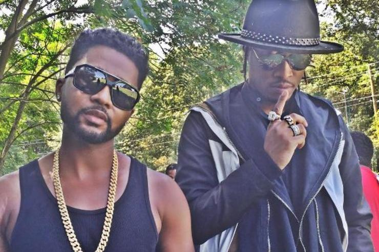 Zaytoven and Future pose for a photo.