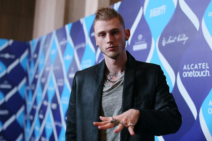 Rapper Machine Gun Kelly attends the 2nd Annual unite4:humanity Presented By ALCATEL ONETOUCH at the Beverly Hilton Hotel on February 19, 2015 in Los Angeles, California.