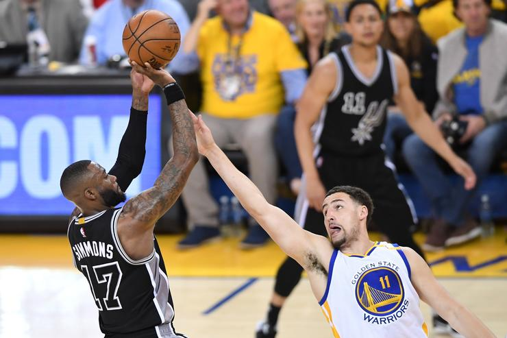 onathon Simmons #17 of the San Antonio Spurs takes a shot against Klay Thompson #11 of the Golden State Warriors