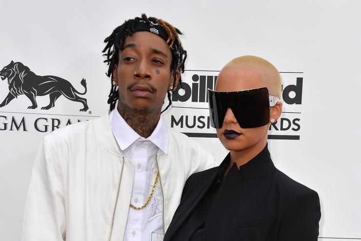 Rapper Wiz Khalifa (L) and model Amber Rose attend the 2014 Billboard Music Awards at the MGM Grand Garden Arena on May 18, 2014 in Las Vegas, Nevada.