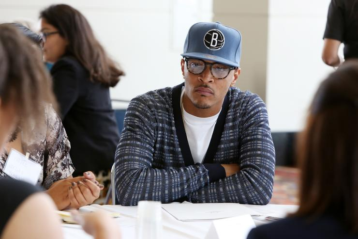 T.I. speaks with youths at a roundtable discussion at Opportunity Fair and Forum on August 13, 2015 in Chicago, Illinois.