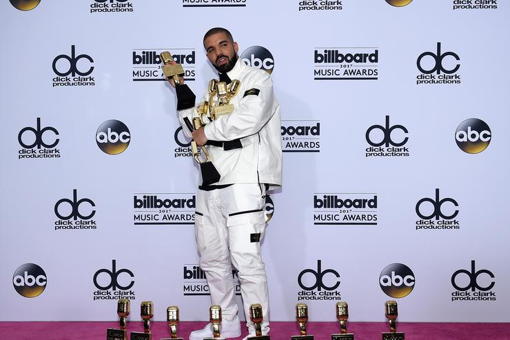 Drake poses in the press room with his awards