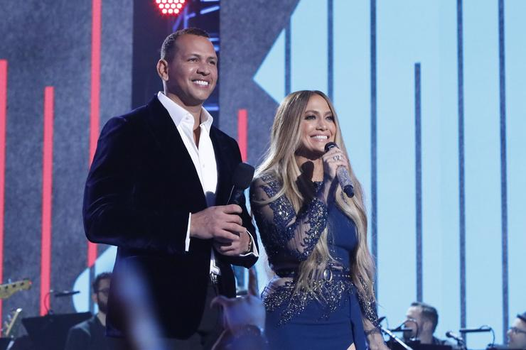 In this handout photo provided by One Voice: Somos Live!, (l-r) Alex Rodriguez and Jennifer Lopez participate in the phone bank during 'One Voice: Somos Live! A Concert For Disaster Relief' at the Universal Studios Lot on October 14, 2017 in Los Angeles, California. (