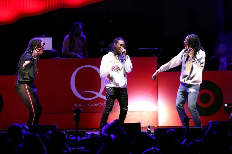 off, Offset, and Quavo of music group Migos perform onstage during 'All-Star Weekend Kick-Off Party' at Capitol Records Tower on February 15, 2018 in Los Angeles, California