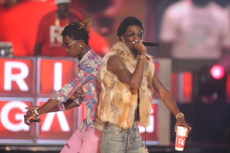Young Thug (L) and Rich Homie Quan perform onstage during the BET Hip Hop Awards 2014 at Boisfeuillet Jones Atlanta Civic Center on September 20, 2014 in Atlanta, Georgia