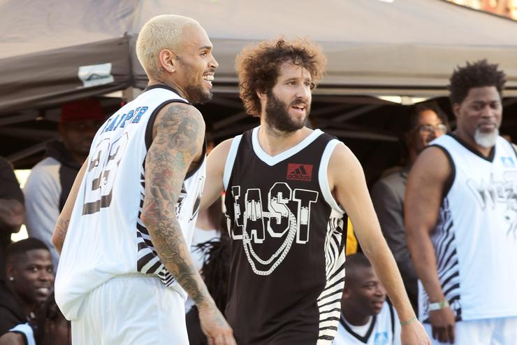 Chris Brown and Lil Dicky play basketball during the East Vs. West game at adidas Creates 747 Warehouse St., an event in basketball culture, on February 16, 2018 in Los Angeles, California