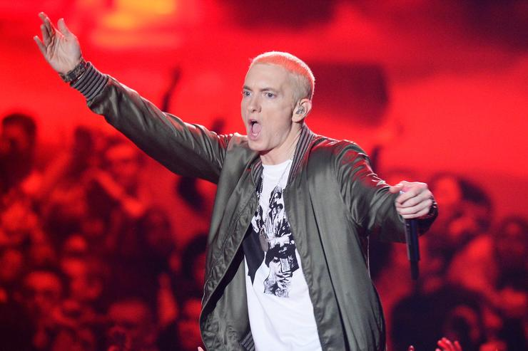 Recording artist Eminem performs onstage at the 2014 MTV Movie Awards at Nokia Theatre L.A. Live on April 13, 2014 in Los Angeles, California.