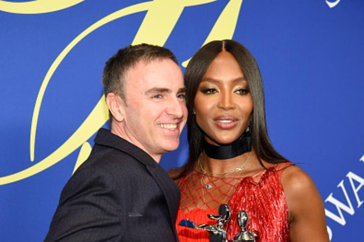 2018 CFDA Womenswear Designer of The Year, Raf Simons and 2018 CFDA Fashion Icon Naomi Campbell attend the 2018 CFDA Fashion Awards Winners Walk at Brooklyn Museum on June 4, 2018 in New York City.