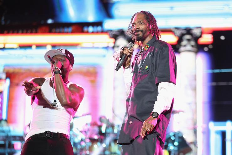 50 Cent (L) and Snoop Dogg perform onstage during day 3 of the 2012 Coachella Valley Music & Arts Festival at the Empire Polo Field on April 15, 2012 in Indio, California