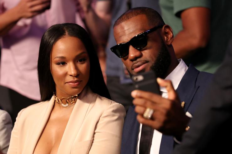 Lebron James and wife Savannah Brinson attends the super welterweight boxing match between Floyd Mayweather Jr. and Conor McGregor on August 26, 2017 at T-Mobile Arena in Las Vegas, Nevada